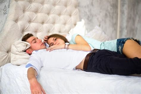 the love bed young love couple in bed girl lying on the boy s shoulder