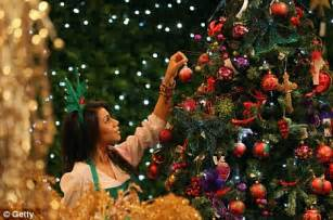 christmas tree preparation selfridges and harrods prepare to open their departments in july daily mail