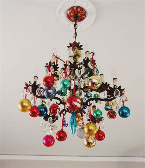 ornaments hung from chandelier christmas decor pinterest