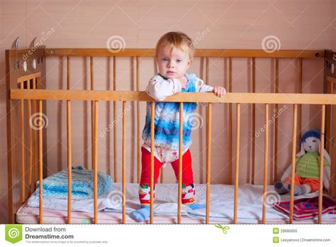 Baby Standing In Crib by Standing Baby In The Crib Royalty Free Stock Photo Image