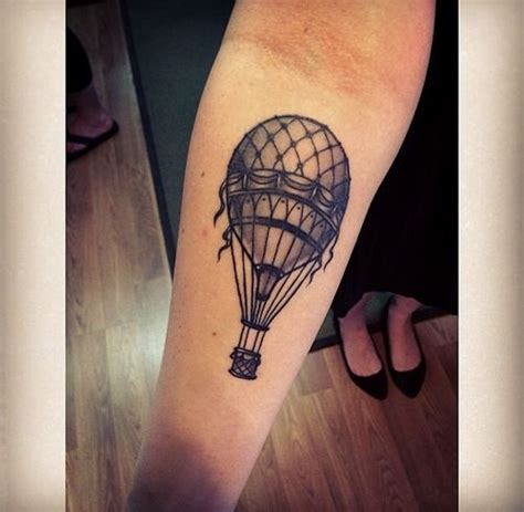 tattoo of hot air balloon done by jeremy sloo hamilton blood sweat and tears