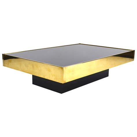 and exclusive brass coffee table by willy rizzo