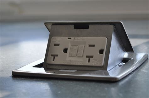 Pop up electrical outlets