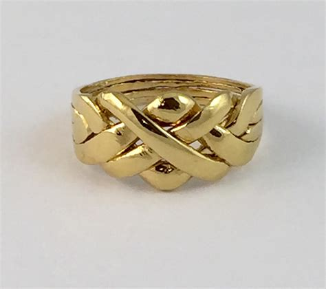 puzzle ring in sterling silver 14k gold plated the original