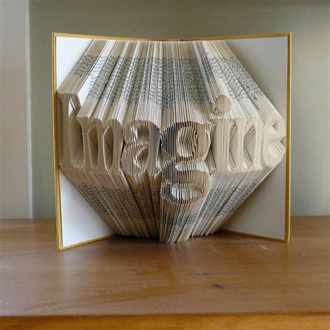 Folded Paper Sculpture - complementing arts folded book sculptures by luciana
