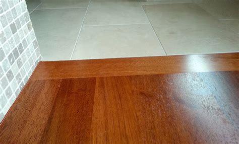 hardwood flooring transition to tile   Carpet, Laminate
