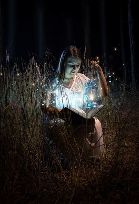 Portrait Of Smiling Woman In Nightgown Sitting At Field At