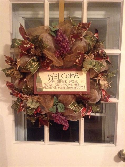 wine themed wreath i just finished for my friend s and his deco mesh wreaths made by