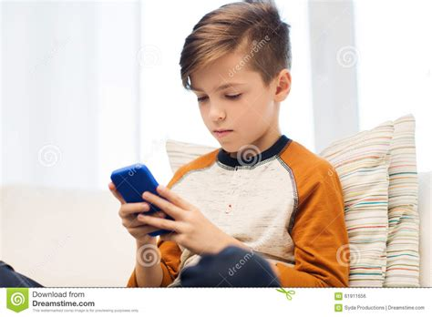 Detox Person by Boy With Smartphone Texting Or At Home Stock Photo
