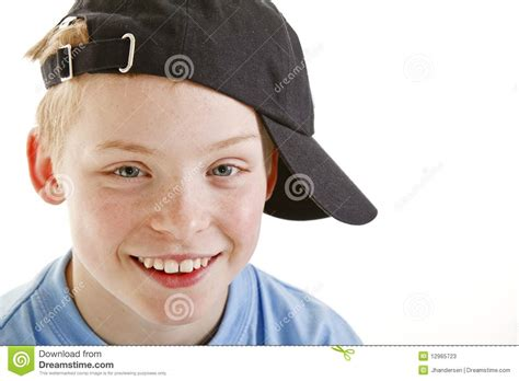 12 year old boy portroets happy smiling 12 year old boy with a cap isolated stock