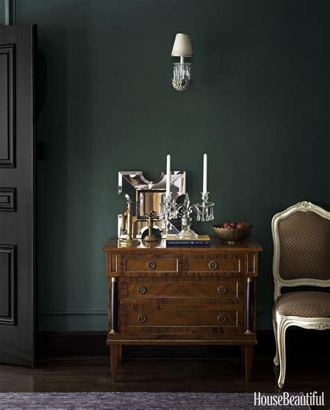 dark green walls inside a home that s not afraid of the dark door trims