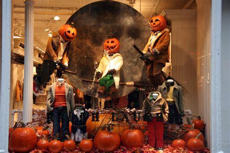 halloween show themes pumpkin heads broomsticks ralph lauren halloween window