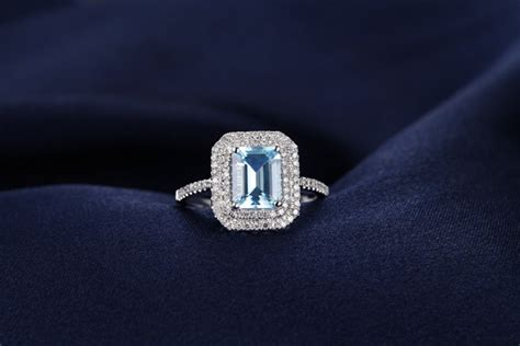 2 carat topaz and halo engagement ring in