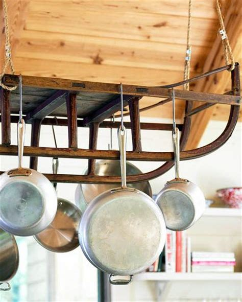 Unique Pot Rack Ideas reclaimed wood and an antique sled come together to make a unique pot hanger for the kitchen