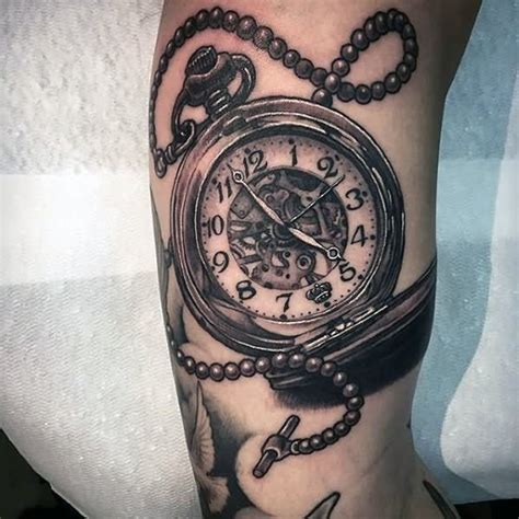 realistic pocket watch tattoo on bicep pocket watch