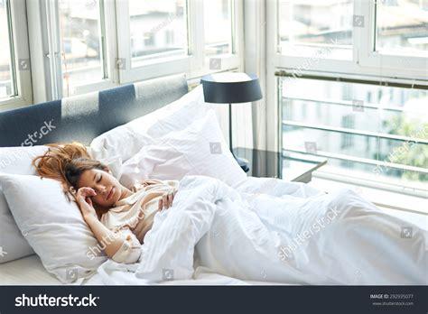 woman sleeping in bed woman sleeping in bed stock photo 292935077 shutterstock