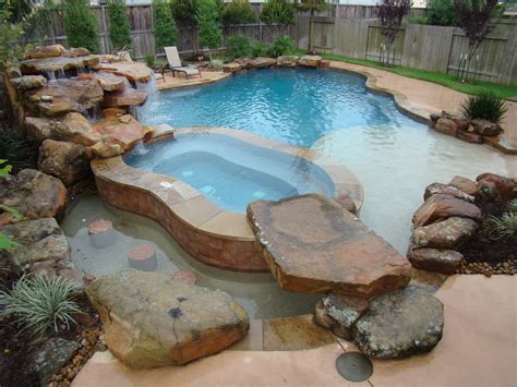 rustic swimming pool with water feature by signature pools of texas zillow digs