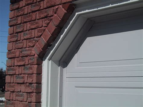 Weather Stripping For Garage Door by How To Insulate The Gaps Between The Garage Door And Side