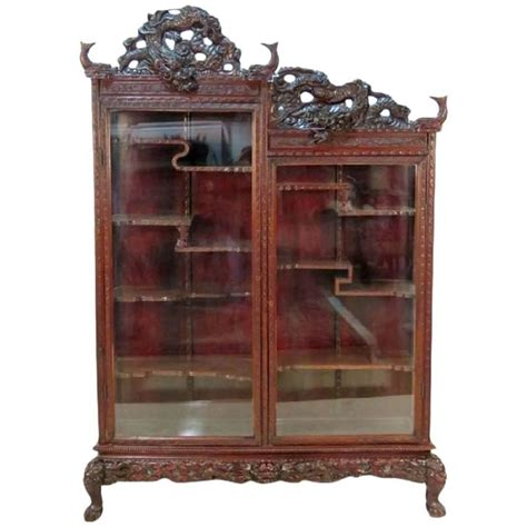 antique figural carved curio cabinet at 1stdibs