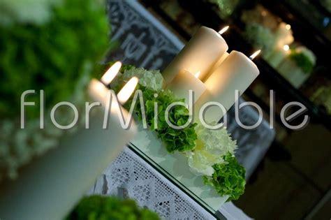 composizioni con candele e fiori fiori verdi per addobbi floreali matrimonio e bouquet
