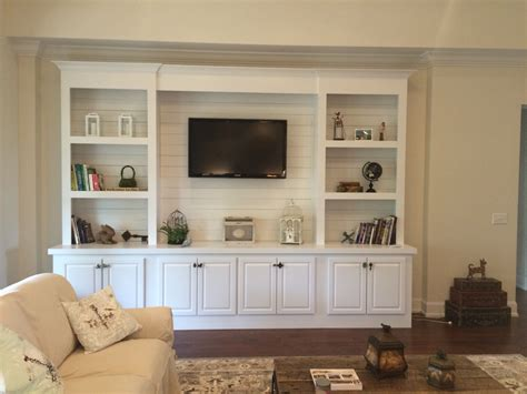 built in bookcase with shiplap back pallet tv stands