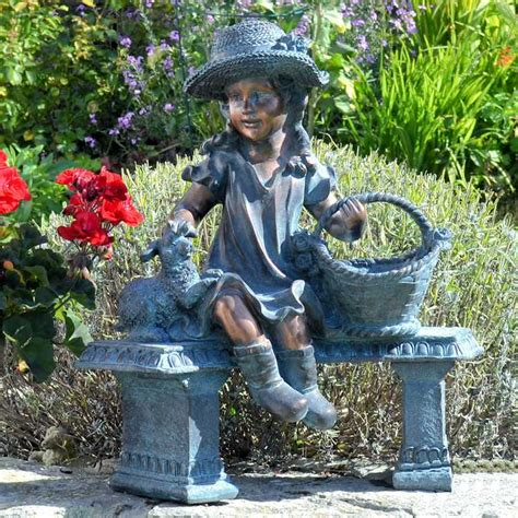 little girl sitting on bench statue ornamental girl with basket and planter for the garden
