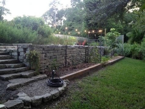 what to do with a sloped backyard here s what people are doing with their sloped backyards