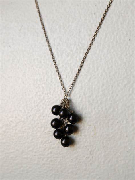 cluster bead necklace black bead cluster necklace a common thread