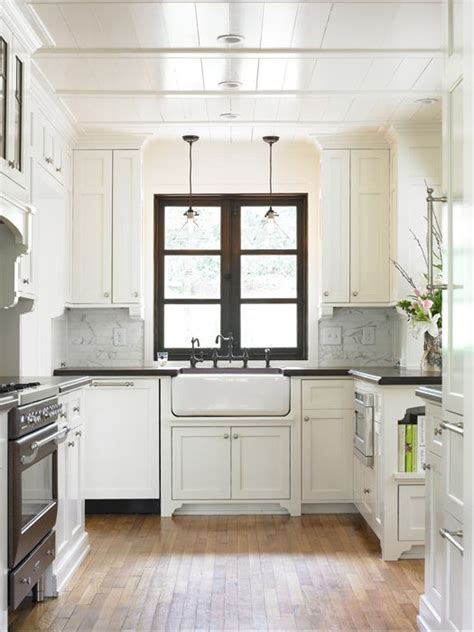 small white kitchens wood window double glass pendants over sink kitchen