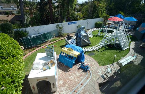 backyard monorail engineer grandfather builds a disneyland themed amusement