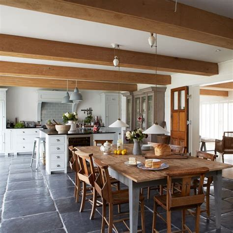 Farmhouse Style Kitchen Diner With Large Wooden Dining