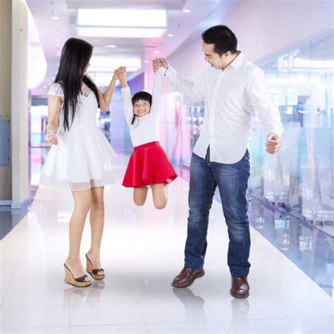 caring mother helping dressing  daughter  walk