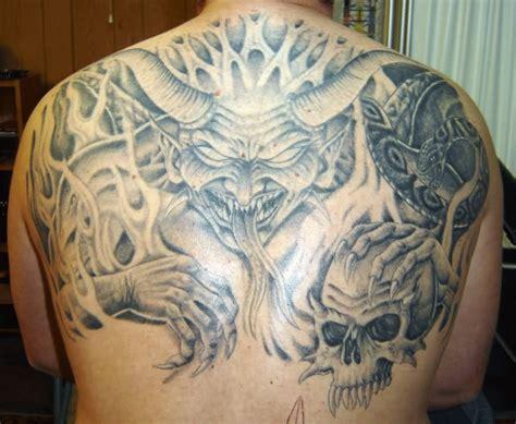 tattoo for upper hand grey ink taurus skull tattoo on upper back