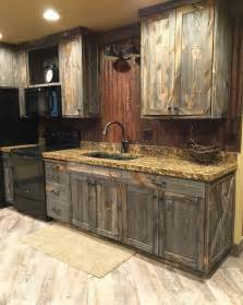 a barnwood kitchen cabinets and corrugated steel