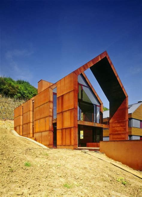 modern cor ten steel and glass house design with unique
