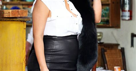 wears skin tight leather skirt fur stole