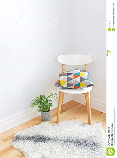 sheepskin rug on chair chair with bright cushion and sheepskin rug on the floor stock photos image 38376993