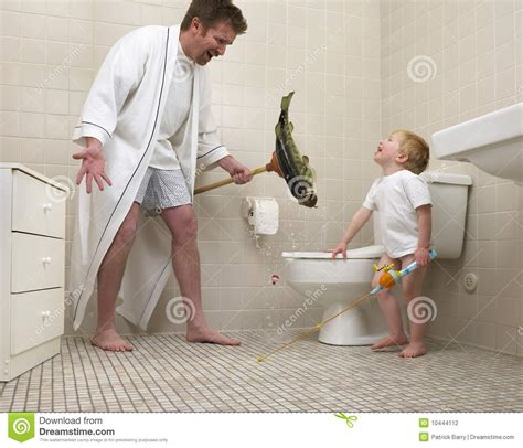 dad in bathroom fishing fun with dad and son stock photography image