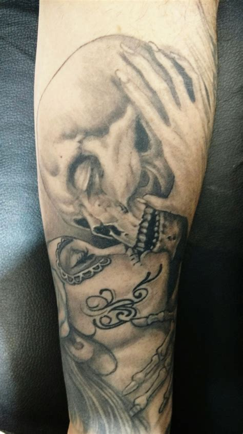 skull kissing tattoo farid certified artist