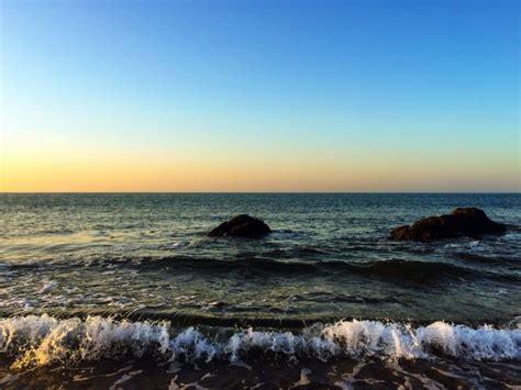 picture ocean rocks sea sky sunrise beach