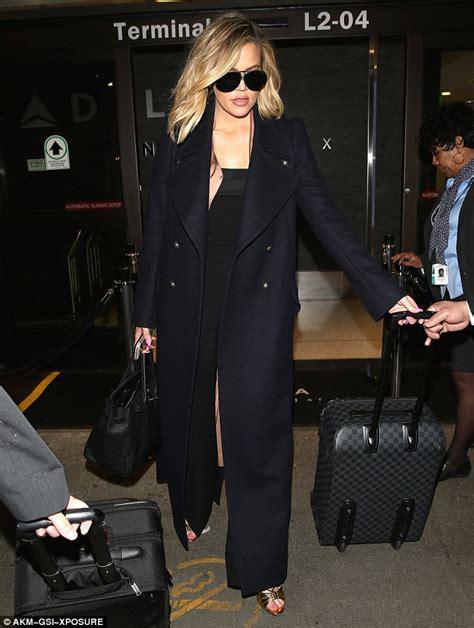 kim kardashian net jumpsuit daily mail khloe kardashian makes glam arrival to lax in strapless