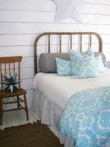 Rustic cottage style bedroom design with whitewashed clap boards and