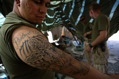 marine corps order on tattoos it s not an order marines get to wear sleeves up
