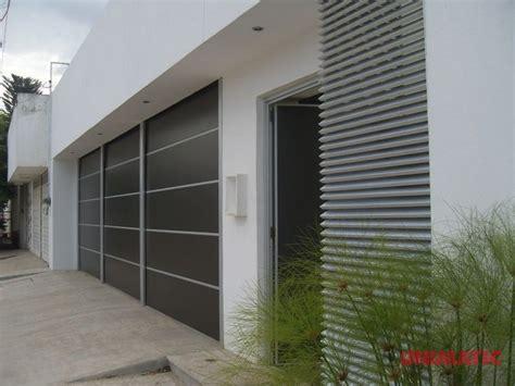 fachadas de garage fachada con porton y puerta de alucobond alucobond