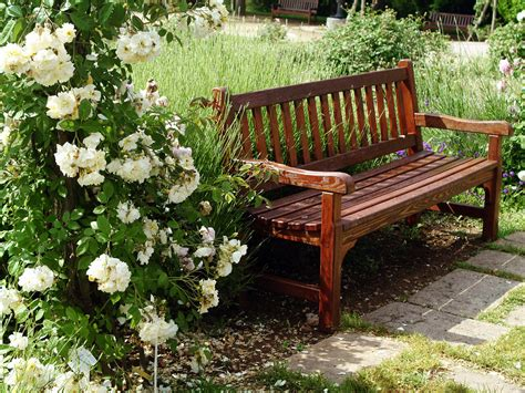bench in a garden pin by alin ajel on garden chair bench pinterest