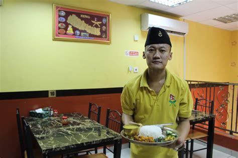 Dining Room Waiter Description For The Momos At Gurkha Nepali Restaurant Qatar
