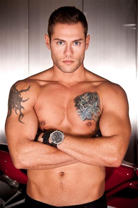 man chest tattoo blue ink flower on chest