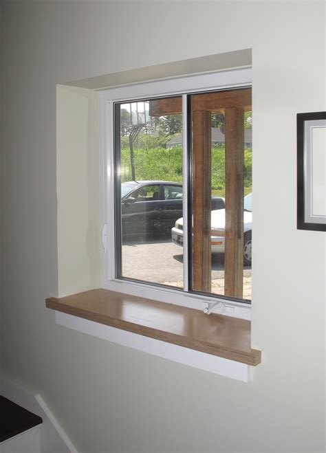 bay window pics with modern white wooden window frames and expose window structure drywall return at jambs and header with wood sill by