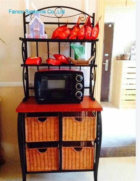 Iron Bakers Rack With Wicker Storage by Iron Wicker Storage Baker S Rack