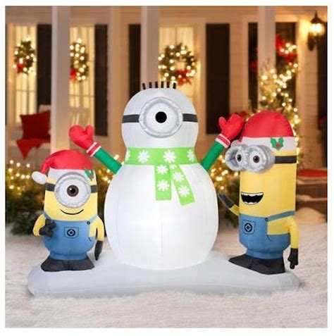 7 airblown inflatable minions building a snowman scene